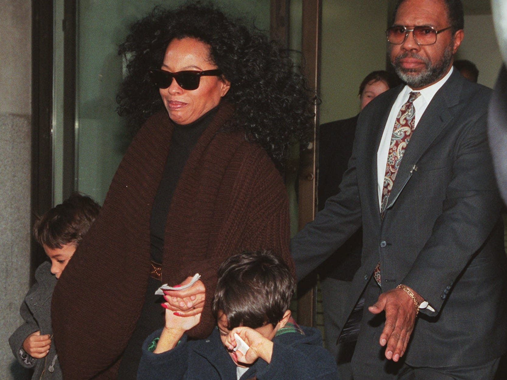Diana Ross, children in hand, exits Beth Israel Medical Center North in New York Friday, Dec. 8, 1995, where Michael Jackson was in intensive care and being treated for a variety of conditions. He was found semiconscious on the side of a stage where he had been rehearsing for an HBO concert special.