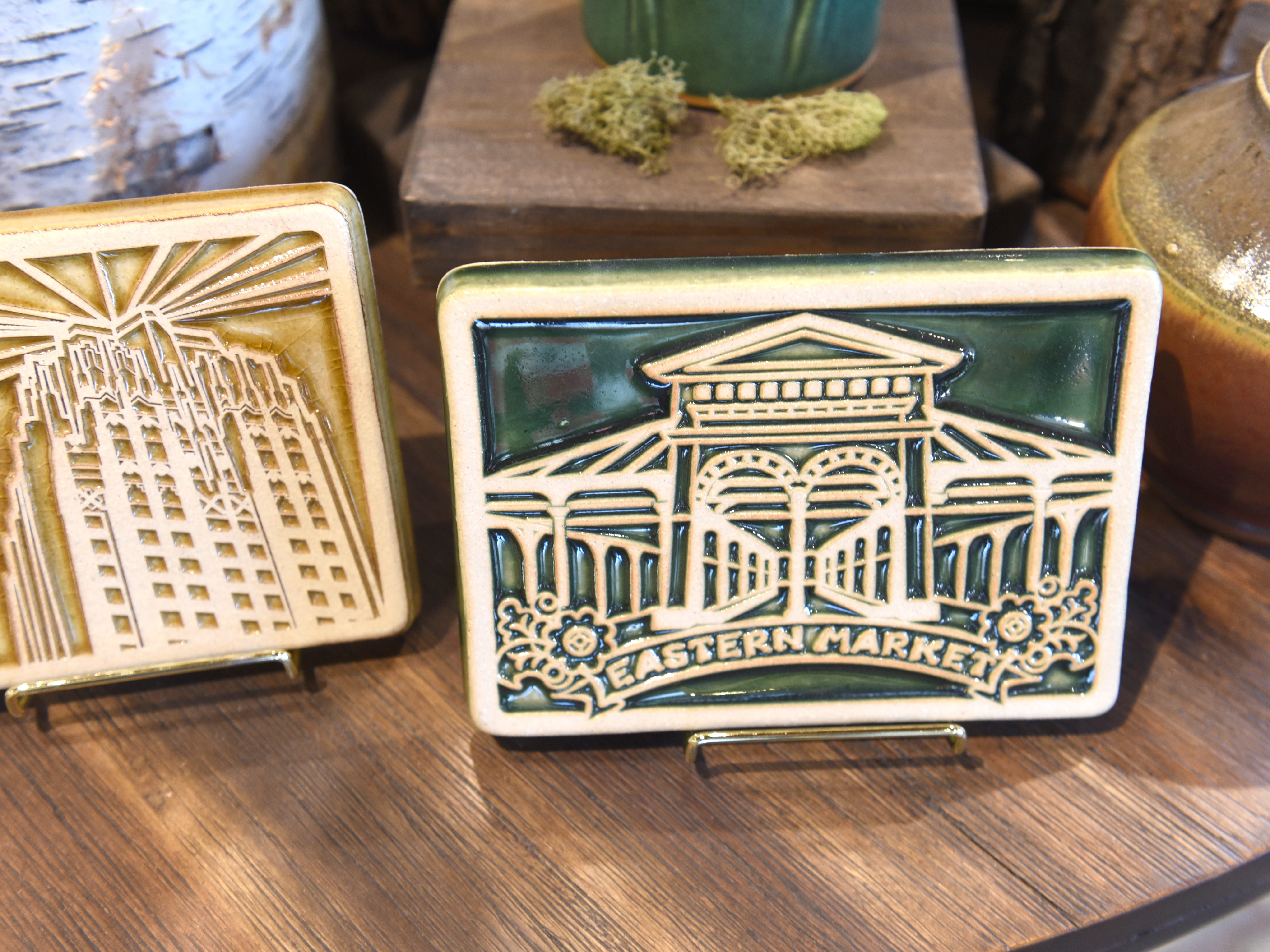 A tile dedicated to historic Eastern Market is made at Pewabic Pottery .
