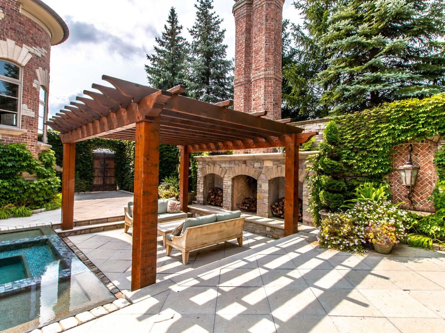 An outdoor seating area with three fireplaces, designed to keep the space usable in the fall and winter.