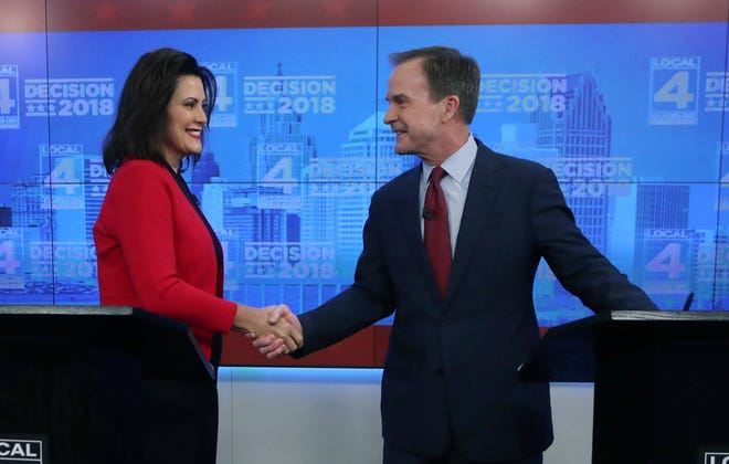 Michigan Democratic gubernatorial candidate Gretchen Whitmer and Republican Bill Schuette, shake hands before their second debate, Wednesday, Oct. 24, 2018 in Detroit.