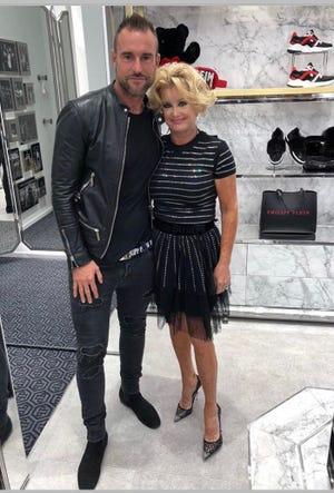 Designer Phillip Plein, left, and Enid Goodman at his store in Las Vegas.