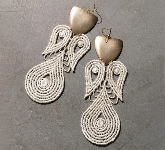 Bold ivory and brass earrings made by Spivak.