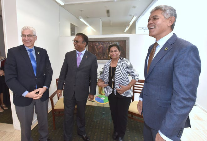 From right, Wayne State President Dr. M. Roy Wilson shares a laugh Thursday with donors Hema Rachmale and her husband Avinash Rachmale, and Farshad Fotouhi, dean of the College of Engineering.