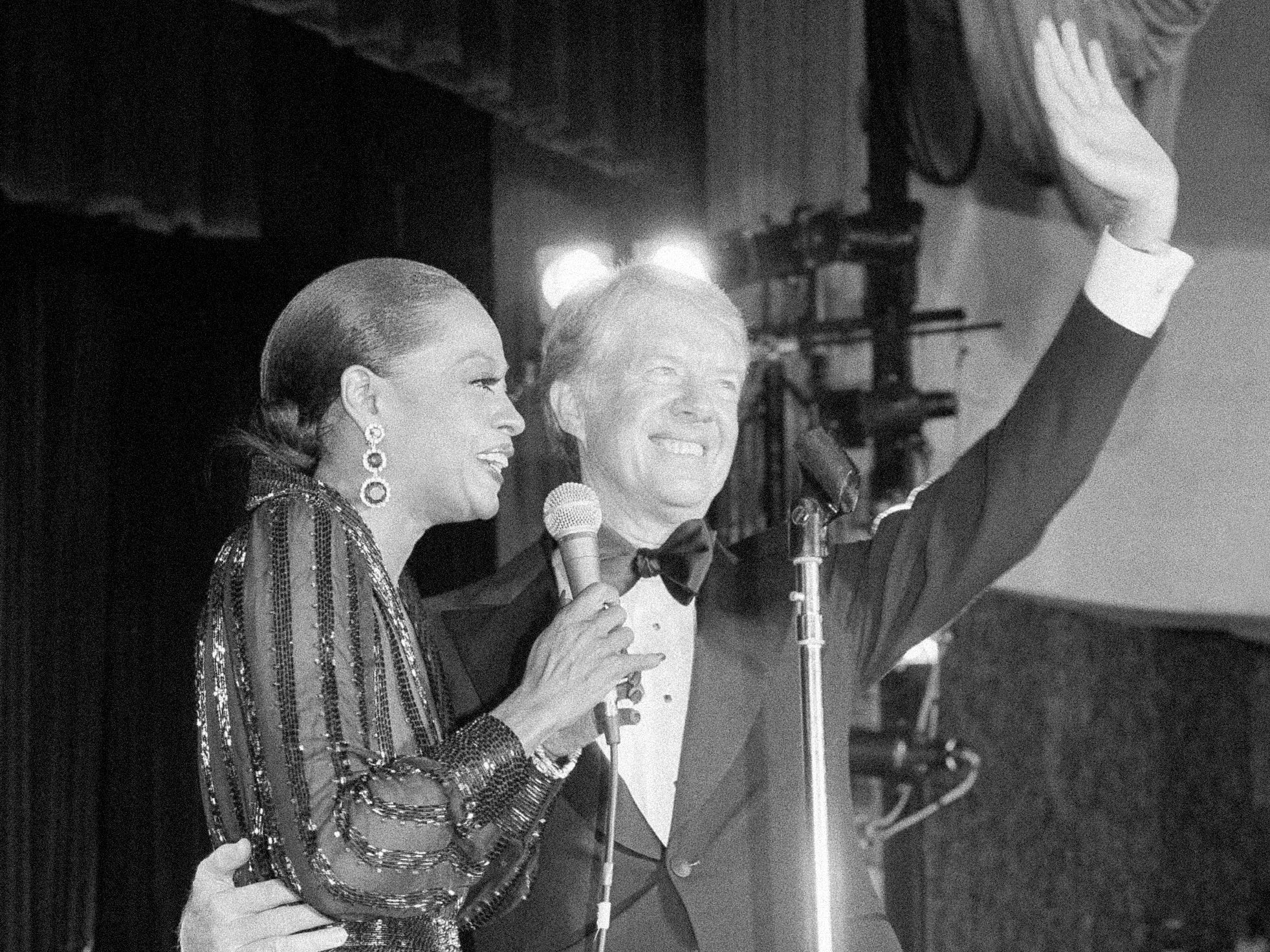 President Jimmy Carter shares the stage with Diana Ross at a fundraiser for the Democratic National Committee in Washington, Sept. 28, 1978. Ross, a Democrat, has sung for many presidents, beginning with Lyndon Johnson.