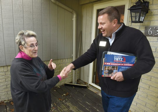 Republican Doug Tietz, a candidate for the 41st Michigan House District seat that includes Troy and Clawson, shakes hands with Sally Raffler of Troy,  as he campaigns in her neighborhood.