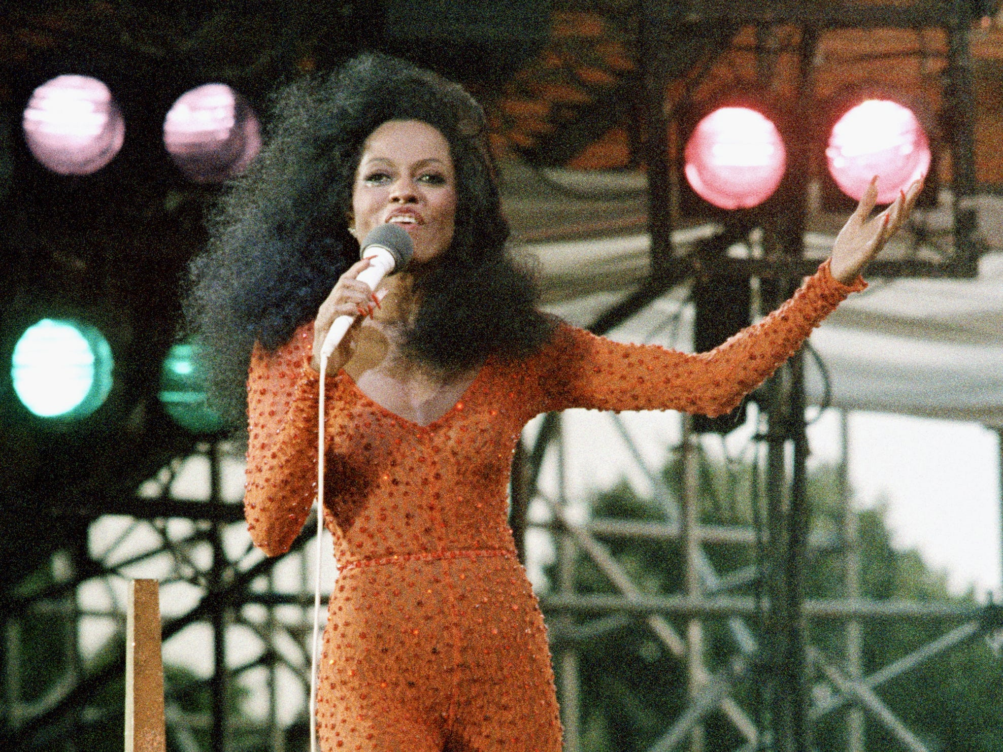 Diana Ross belts out a song to the huge crowd at  her free concert in New York's Central Park, July 21, 1983.