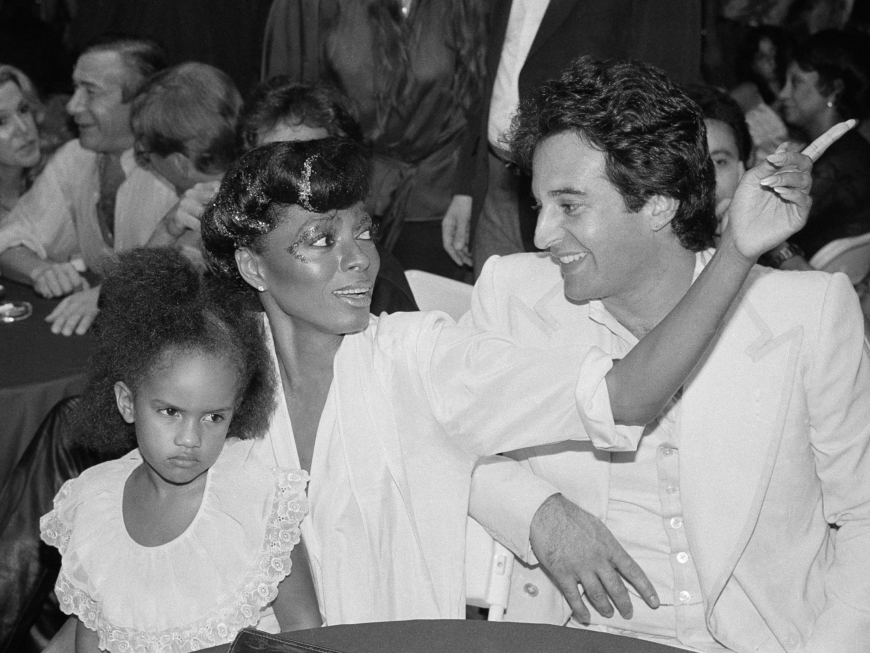 Diana Ross chats with her ex husband, Robert Ellis Silverstein, right, in August 1979, before the start of a performance by Mary Wilson, who was by now a solo artist.  Ross holds 4-year-old Tarkasa, Mary Wilson's daughter, on her lap.