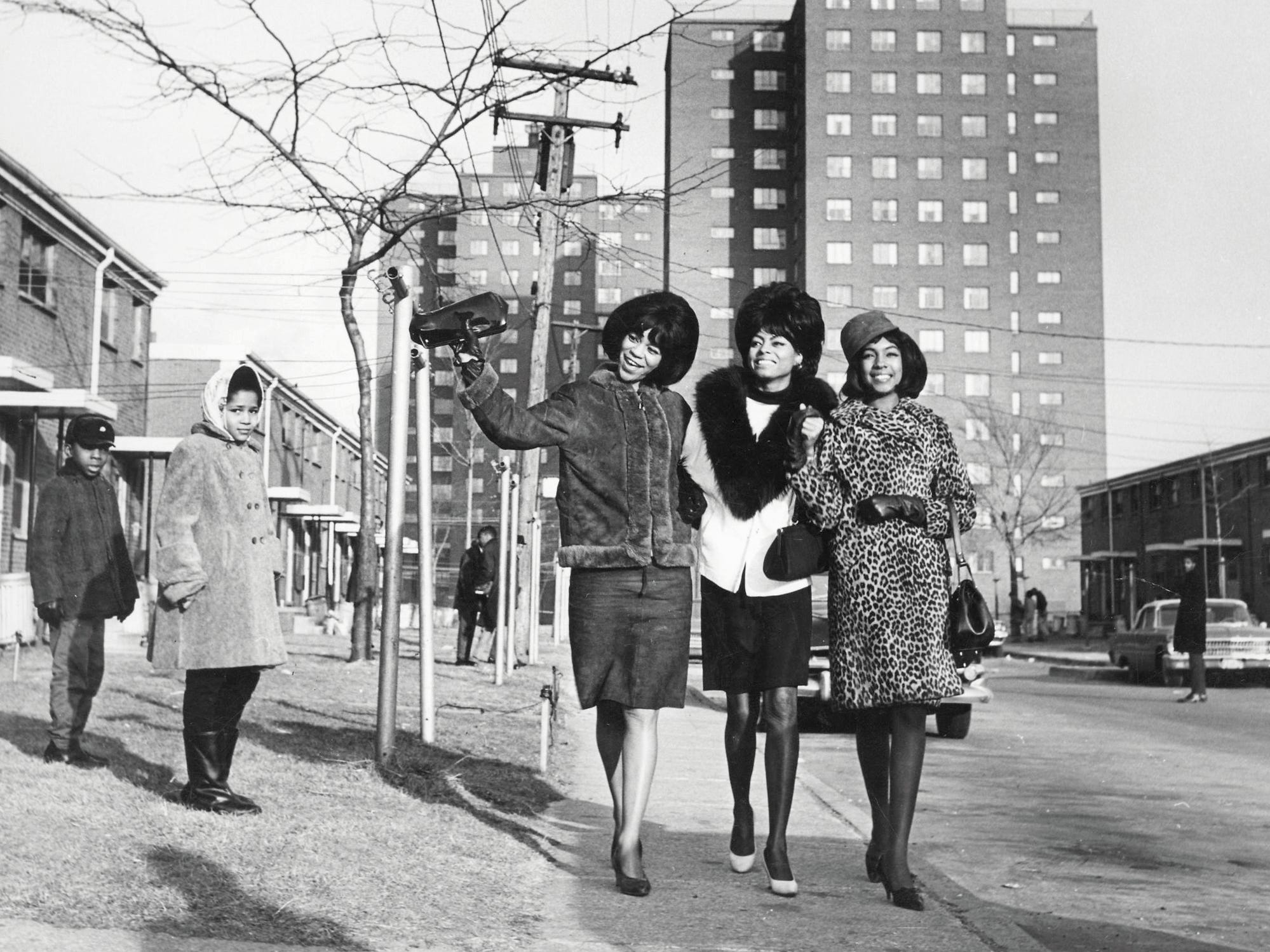 Florence Ballard, Diana Ross and Mary Wilson walk near Detroit's Brewster-Douglass housing projects in 1965. They grew up there, and remembered residents singing and dancing in the streets, inspired by songs they heard on the radio.