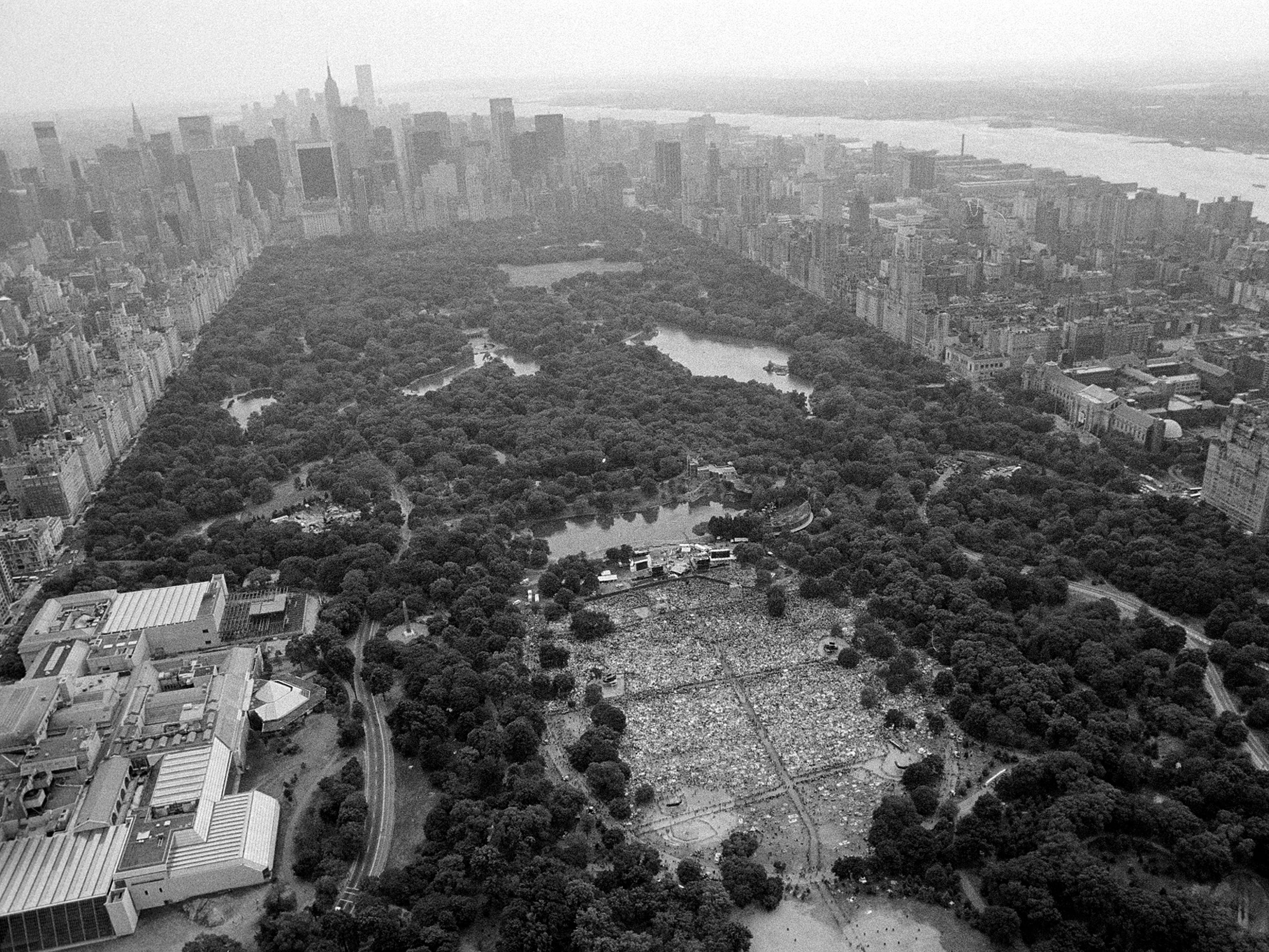 About 350,000 people fill New York's Central Park on July 21, 1983 for a free concert by Diana Ross. A heavy rainstorm ended the performance after 45 minutes.