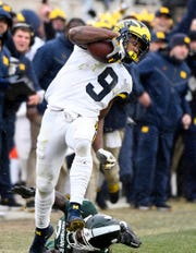 Michigan's Donovan Peoples-Jones  escapes from Michigan State cornerback Tre Person for a 79-yard touchdown in the Wolverines' 21-7 victory.