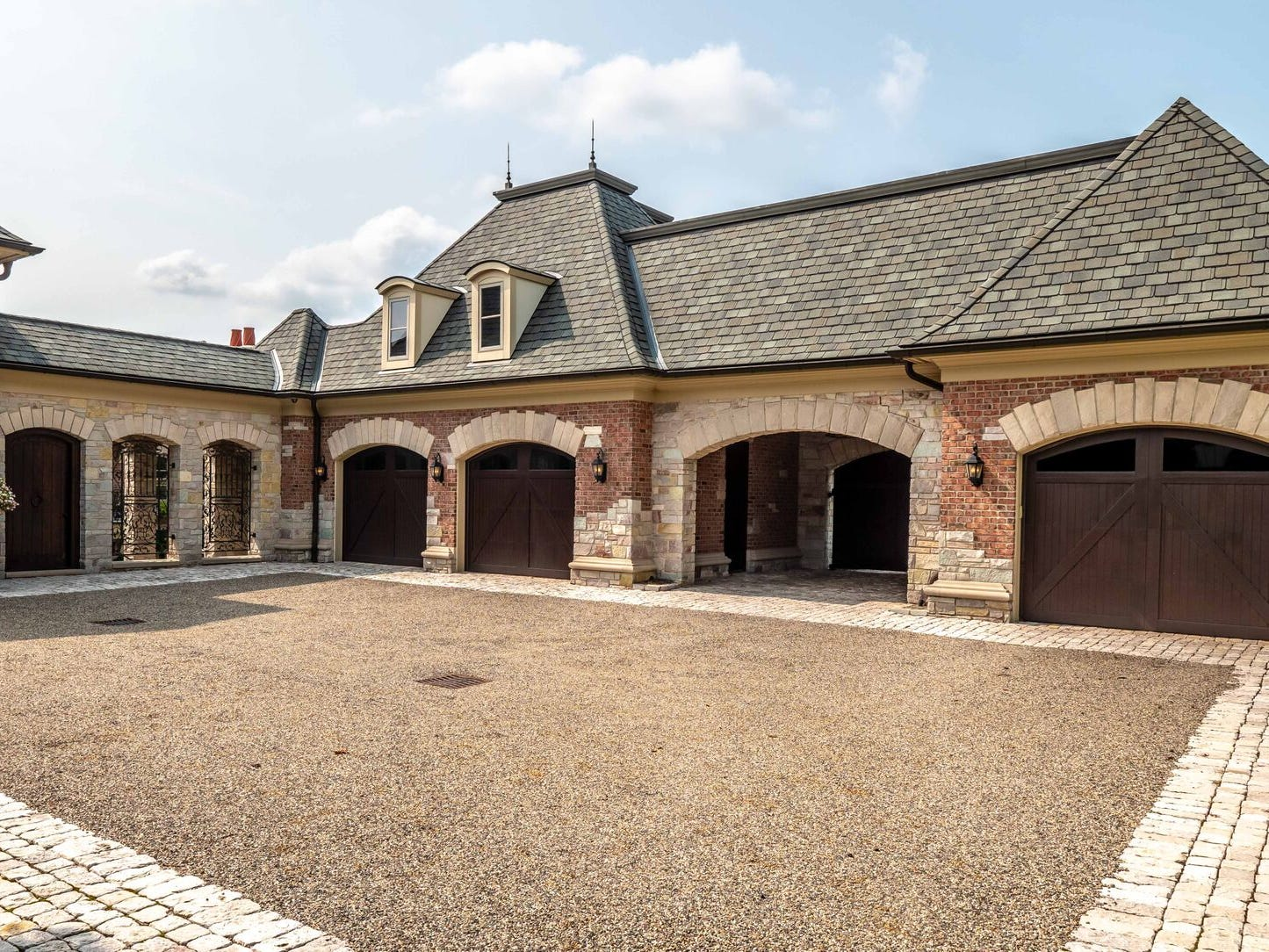 The eight car garage features its own car wash.