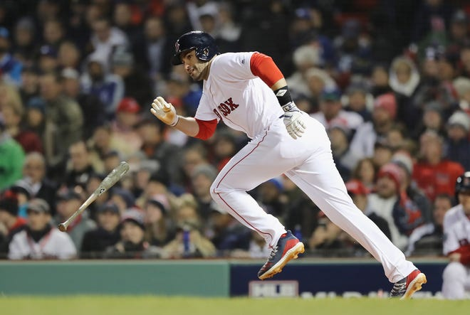 J.D. Martinez's two-run single in the fifth inning helped lift the Red Sox to a 4-2 win over the L.A. Dodgers in Game 2 of the World Series on Wednesday in Boston.