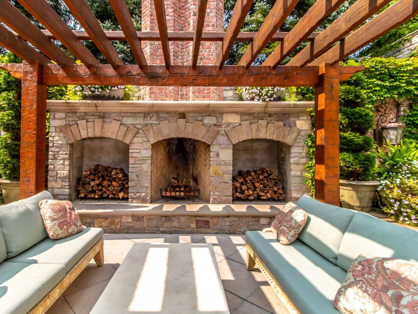 Poolside seating with three fireplaces.