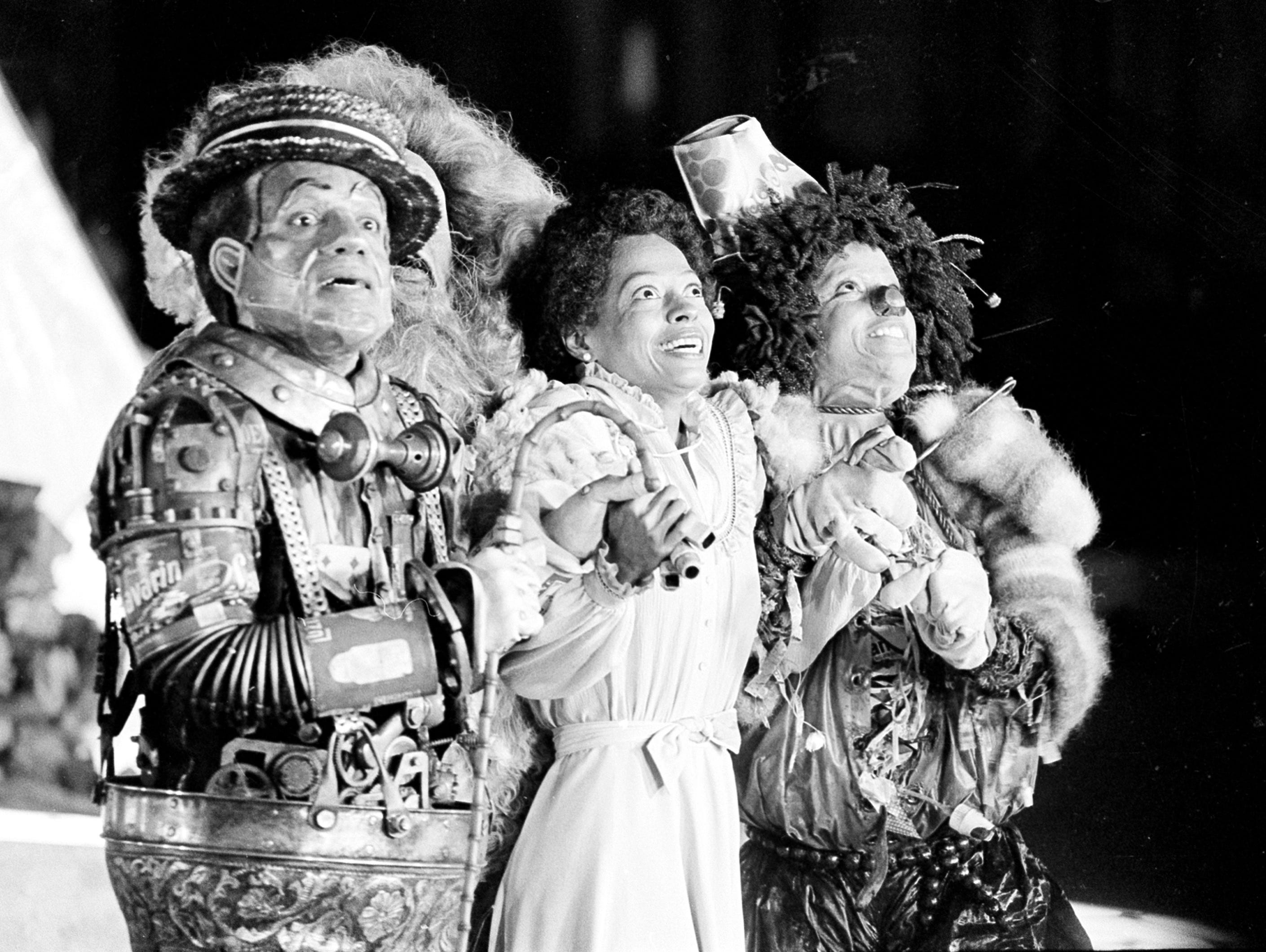 "In this Oct. 4, 1977 photo, Diana Ross,  as Dorothy, Michael Jackson, right, as Scarecrow and Nipsey Russell as Tinman perform during filming of the musical ""The Wiz"" in New York. Ted Ross, portraying the Lion, is partly hidden behind Russell. The film bombed but later developed a cult following."