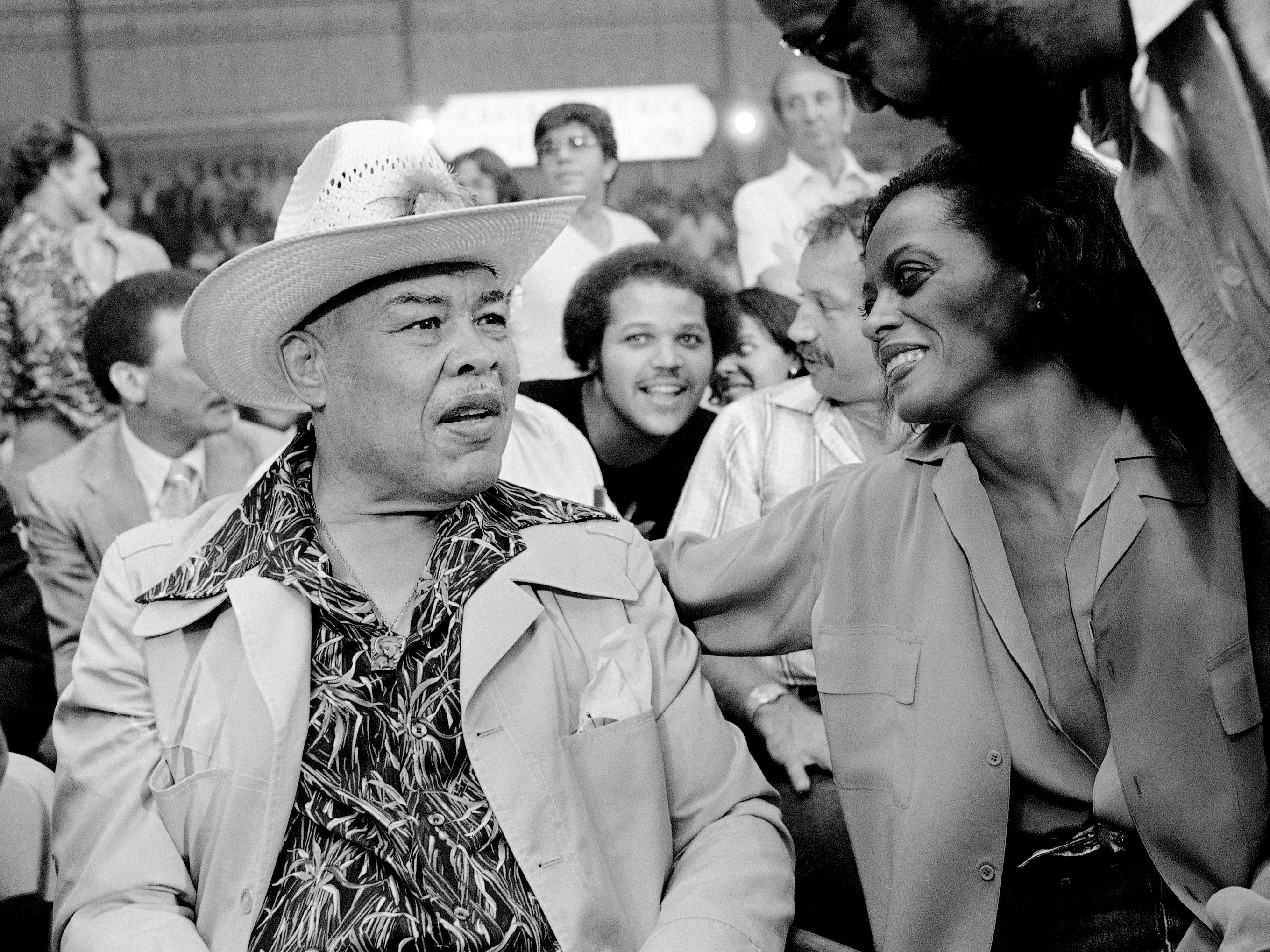 Two Detroit icons, former heavyweight boxing champion Joe Louis and Diana Ross, talk at Caesars Palace in Las Vegas on Sept. 28, 1979, where both were on hand to watch the Larry Holmes-Earnie Shavers heavyweight championship fight.