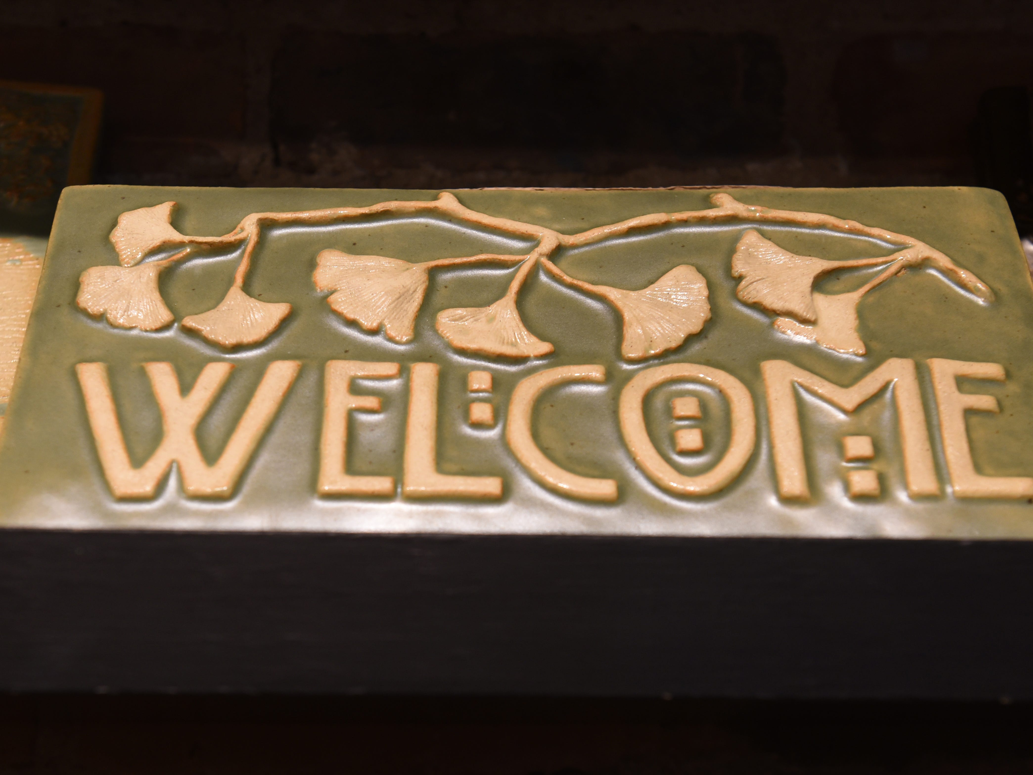 A welcome sign made at Pewabic Pottery.