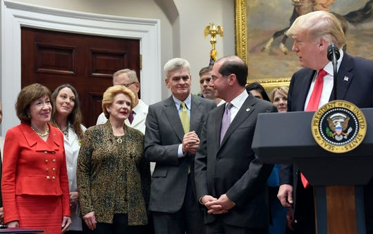 Sen. Debbie Stabenow attends a White House ceremony on Oct. 10, 2018 for the signing ceremony for the 'Patient Right to Know Drug Prices Act' and 'Know the Lowest Price Act of 2018,' with fellow senators Susan Collins, R-Maine, left,  and Sen. Bill Cassidy, R-La., Health and Human Services Secretary Alex Azar, and President Donald Trump.