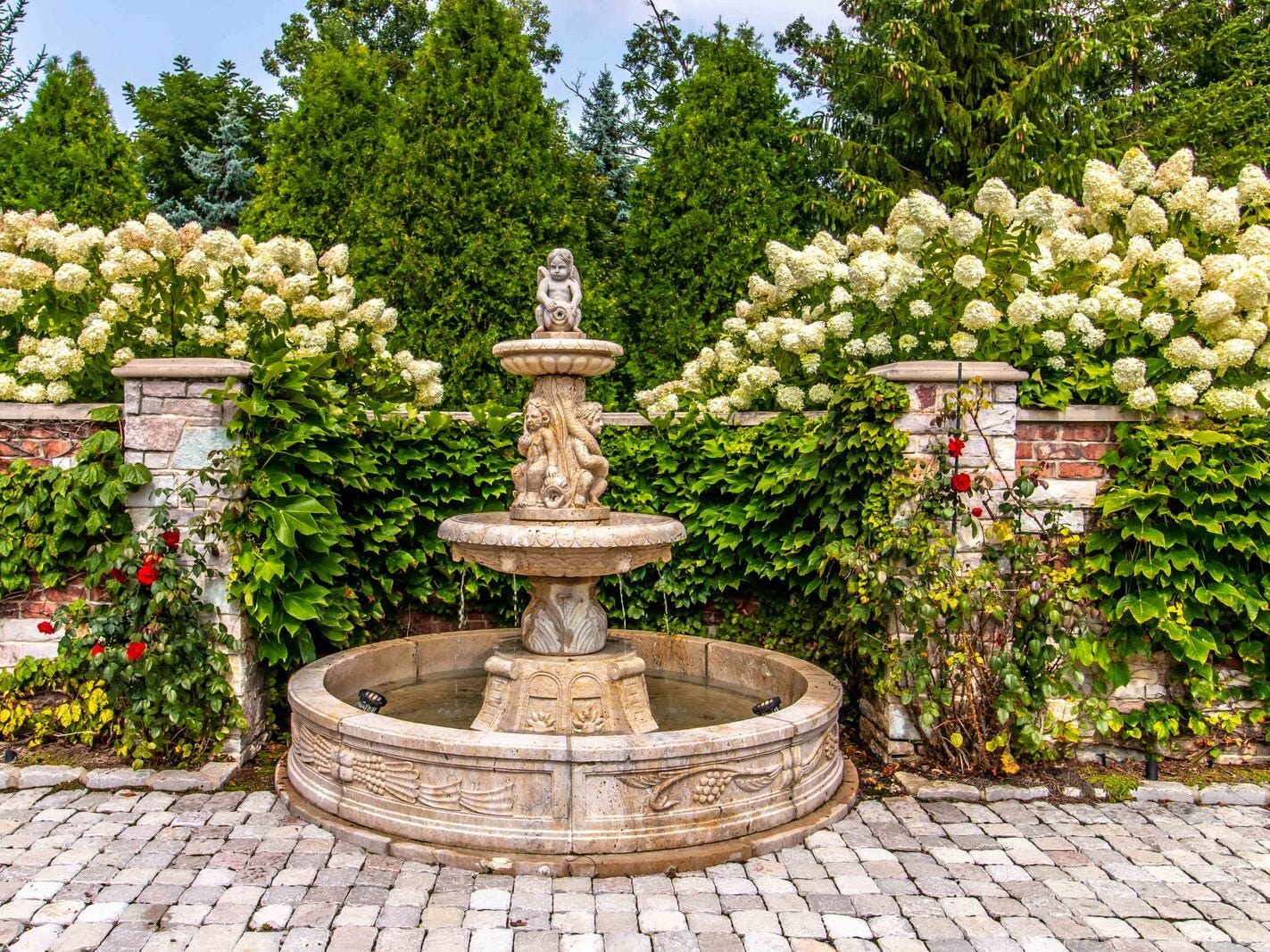 The grounds are full of villa-inspired details, like this tiered fountain.