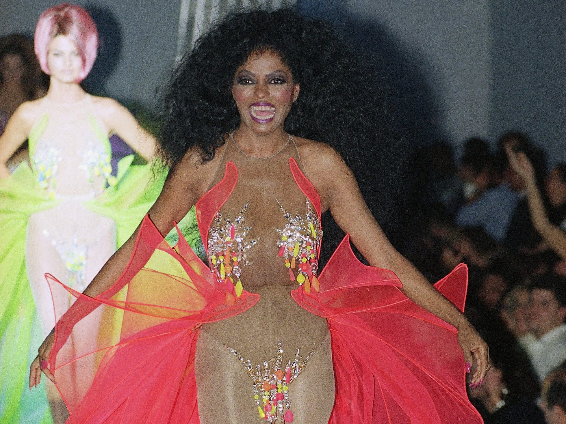 Diana Ross takes a turn down the runway as a guest model for French fashion designer Thierry Mugler's summer ready-to-wear collection in Paris, Oct. 10, 1990.