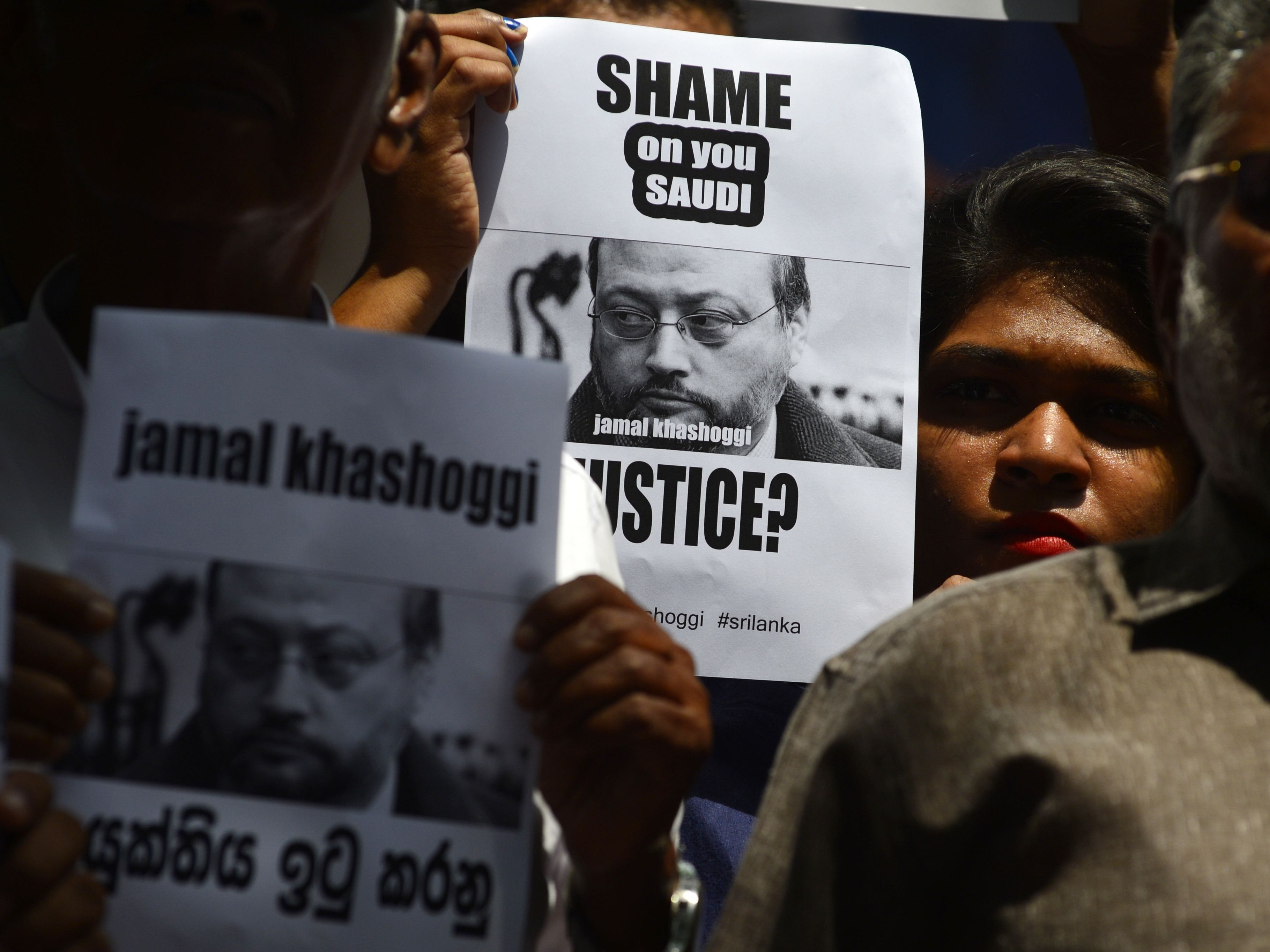 "Members of the Sri Lankan web journalist association hold placards with the image of Saudi journalist Jamal Khashoggi during a demonstration outside the Saudi Embassy in Colombo on October 25, 2018, following Khashoggi's dissapearance on October 2 at the Saudi consulate in Istanbul. - Saudi Arabia's crown prince denounced the ""repulsive"" murder of journalist Jamal Khashoggi and vowed justice will prevail, in his first public comments on the case, without addressing US accusations of a monumental cover-up."