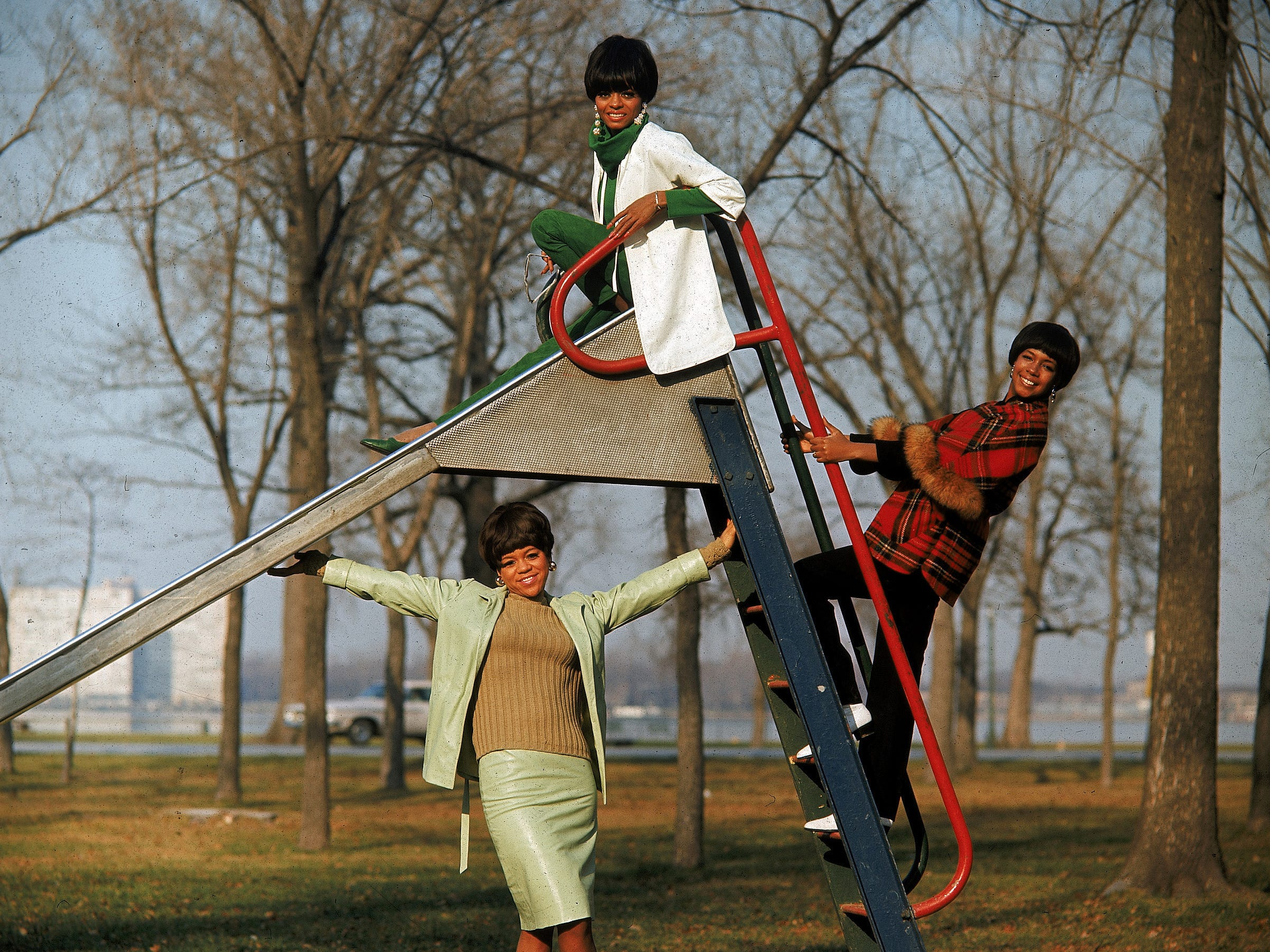 The Supremes pose on a slide in a Detroit park for a photo shoot on Aug. 19, 1966.