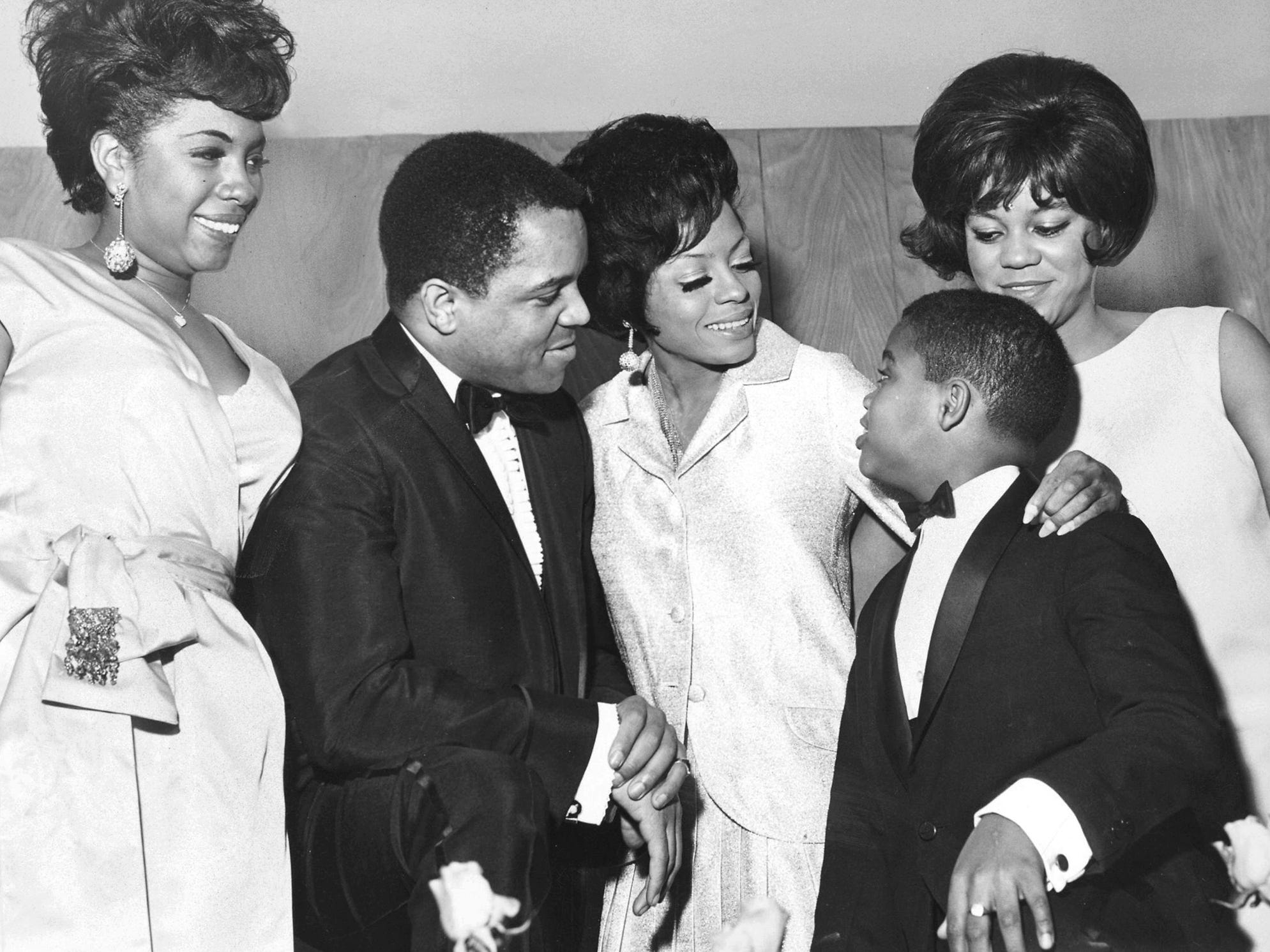 The Supremes are seen with Berry Gordy Jr. and Berry Gordy IV at an event in January 1966. Diana Ross is at center next to Berry Gordy Jr., her mentor and later her paramour, and the father of her daughter Rhonda.