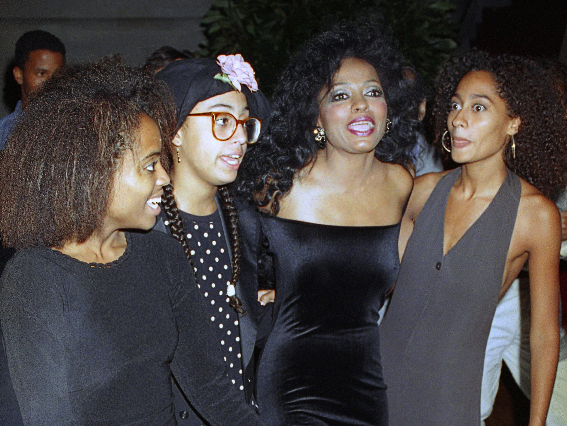 Diana Ross is joined by daughters, from left, Rhonda, Chudney and Tracee at a party following her opening night performance at New York's Radio City Music Hall on Sept. 20, 1991.  Her concert songlists at that time delivered a mix of ballads, pop, blues, jazz and disco.