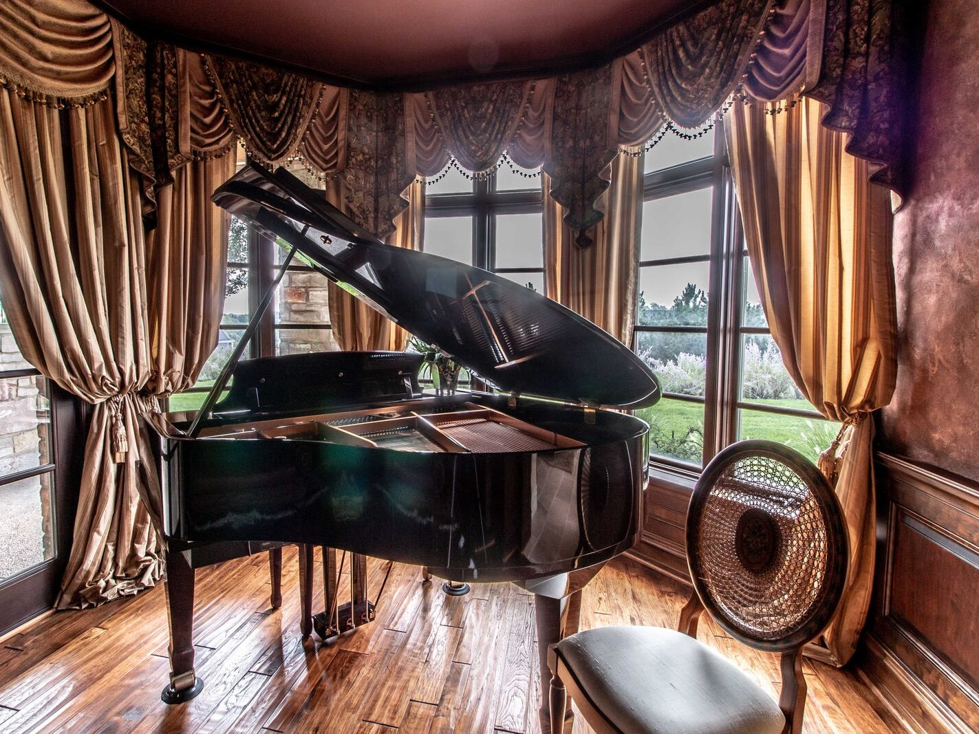 The baby grand piano has its own nook.