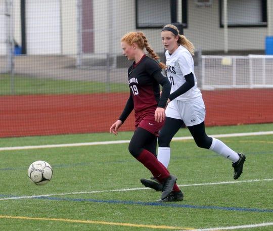 Caylee Boorse of Elmira dribbles the ball as Kenna Newman of Corning defends during a Section 4 Class AA girls soccer semifinal Oct. 24, 2018 at Ernie Davis Academy.