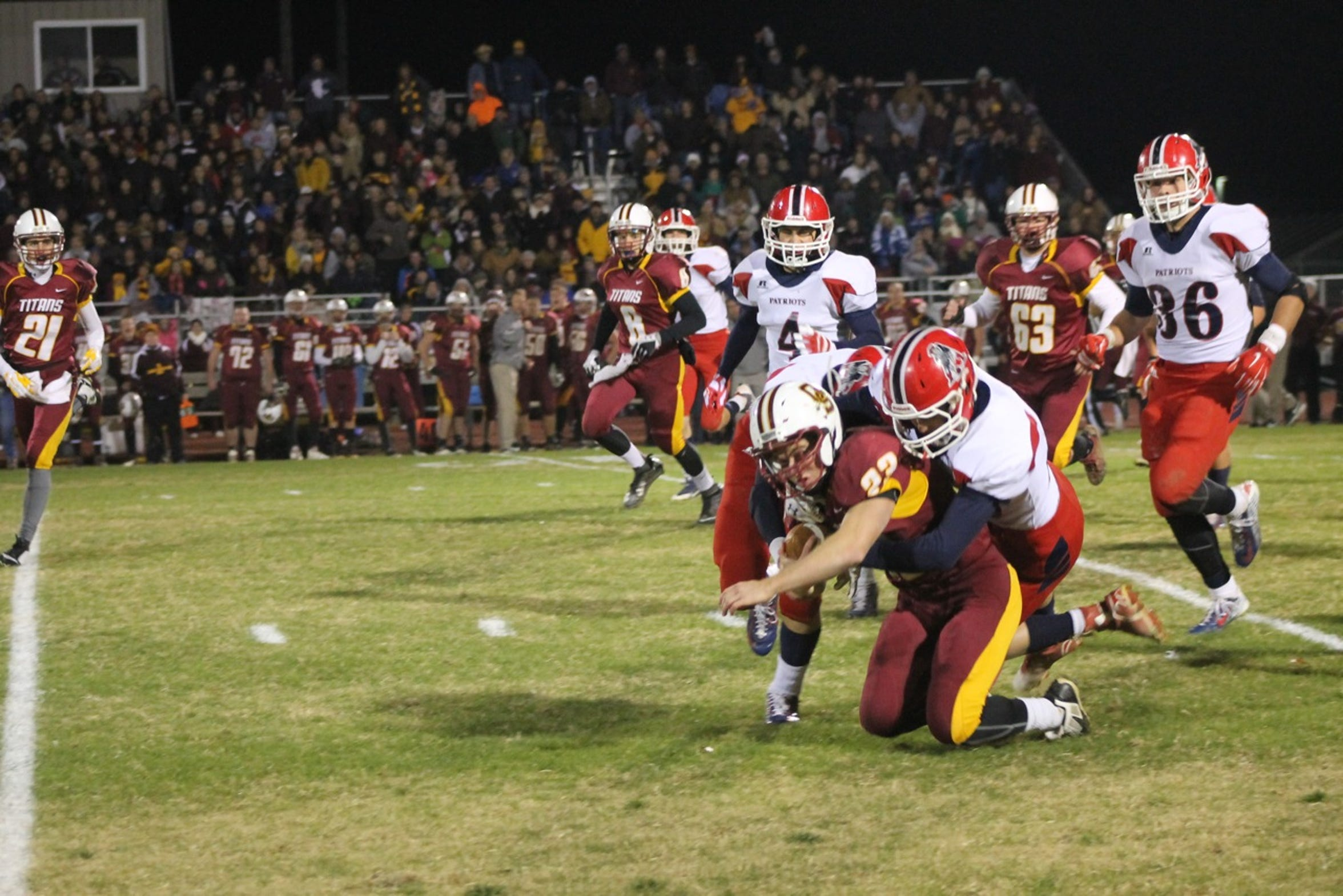 Gibson Southern's Cody Pohl is tackled by a pair of Heritage Hills defenders in the Class 3A Sectional 32 championship game on Nov. 7, 2014 in Fort Branch, Ind. Heritage Hills won, 14-13.