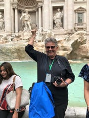 Italian holiday Stopping for a moment to throw a coin in the Trevi Fountain is Yvonne Sippel during a 16-day whirlwind trip through Italy.
