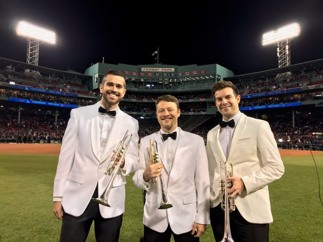 Former Harrison student Ben Wright (center) played the National Anthem Tuesday before Game 2 of the World Series at Fenway Park. He was joined by fellow Boston Symphony members Mike Martin (left) and Tom Siders (right).