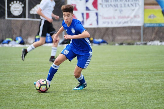 Carson Kelly, 14, has been playing soccer since he was 5. He is now playing at a Minnesota boarding school and is part of the Olympic Development Program.