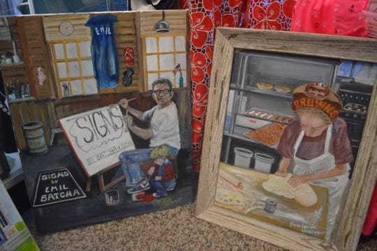 These paintings, depicting Emil Batcha and Jill Schrock, are part of Lucas Haninger's series of paintings honoring the people of Marblehead.