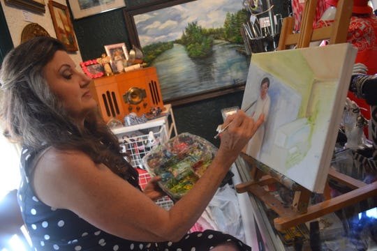 Rose Lucas Haninger paints a portrait of Johnny Danchisen, who helped run Erie Market in the 1960s. The portraits depict the beloved people from Lucas Haninger's memories as well as her life today.