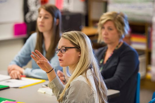 Fifth-grade teacher Madison Witkin talks about her student's performance during a weekly meeting with fellow teaching staff at Putnam Elementary School on Thursday, October 25, 2018. Teachers at the school meet weekly to discuss their student's performance and how to break down gaps on student achievement.