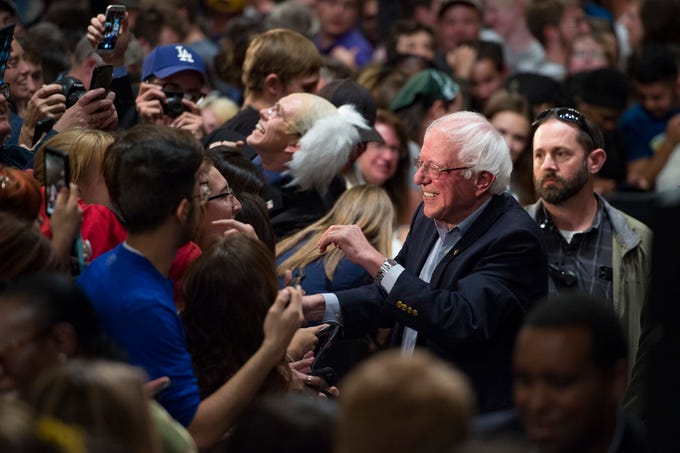 U.S. Sen. Bernie Sanders shakes hands with supporters as he campaigns for Democratic candidate for Colorado Governor Jared Polis during a rally at the Lory Student Center at CSU on Wednesday, October 24, 2018.
