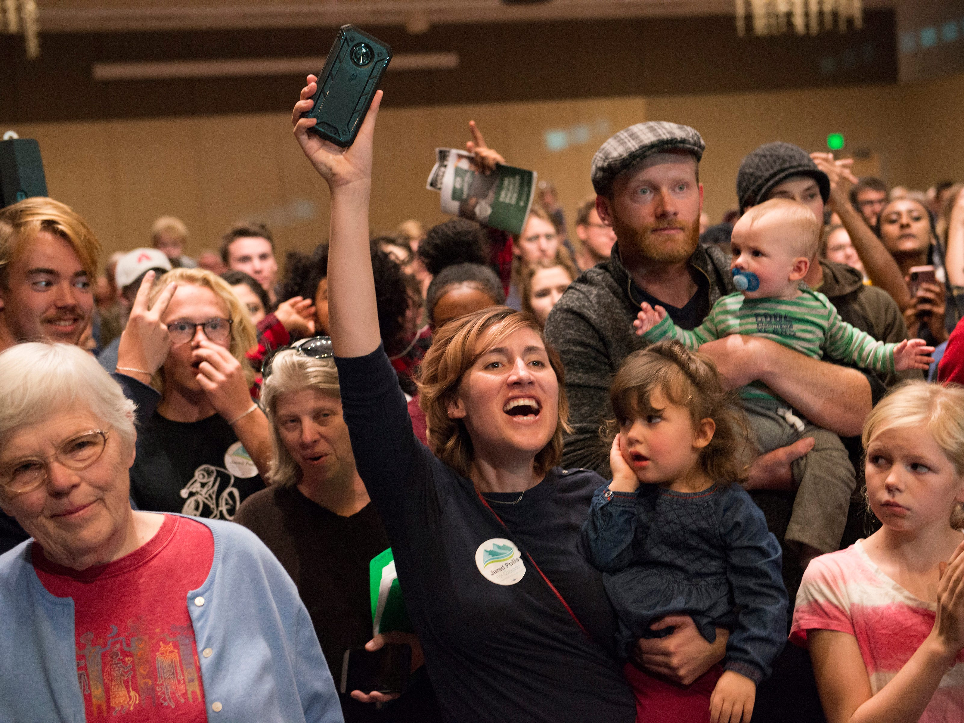 People cheer as U.S. Sen. Bernie Sanders speaks to a crowd of around 1,800 as he campaigns for Democratic candidate for Colorado Governor Jared Polis during a rally at the Lory Student Center at CSU on Wednesday, October 24, 2018.