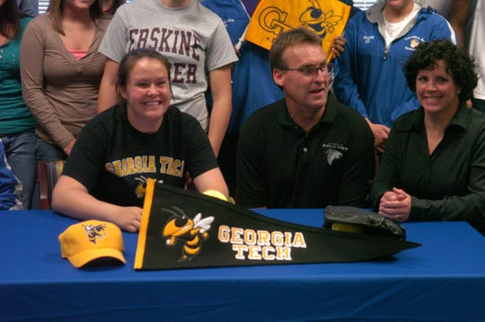 Rachel Glazebrook ( left) surrounded by family and friends at Travelers Rest High School Friday, April 17, 2009, signs a letter of intent to attend Georgia Tech and play softball.