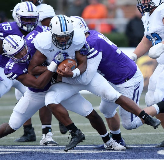 Furman's Donavan Perryman, left, and Chris Washington sack The Citadel quarterback Jordan Black (10).