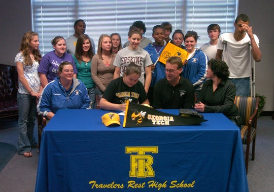 Rachel Glazebrook (seated, 2nd from left) surrounded by family and friends at Travelers Rest High School Friday, April 17, 2009, signs a letter of intent to attend Georgia Tech and play softball.