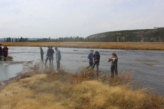 The students working on the water sampling research.
