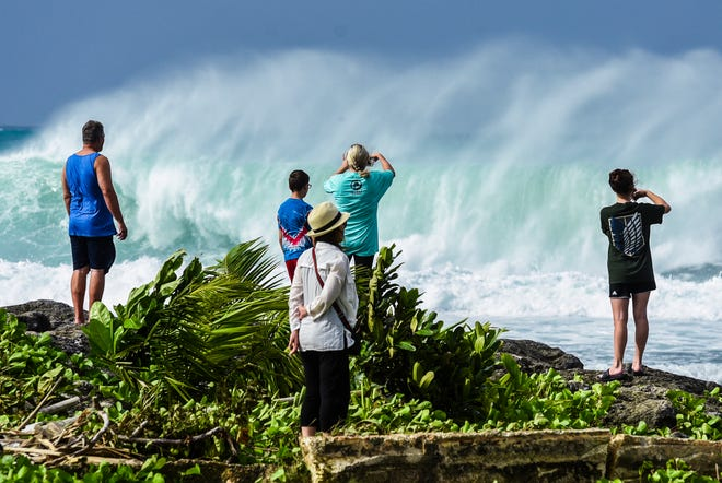 Huge waves breaking at the mouth of the Hagåtña boat basin on Thursday, Oct. 25, 2018, offered the opportunity for spectacular images or online-worthy selfies.