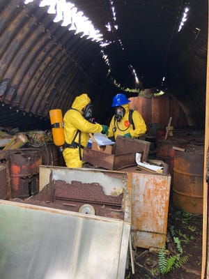 Officials from Unitek Environmental Guam take samples of drums at Nimitz Hill/Lonfit Quonset hut. Guam Environmental Protection Agency on Thursday said the drums are not connected to Agent Orange.