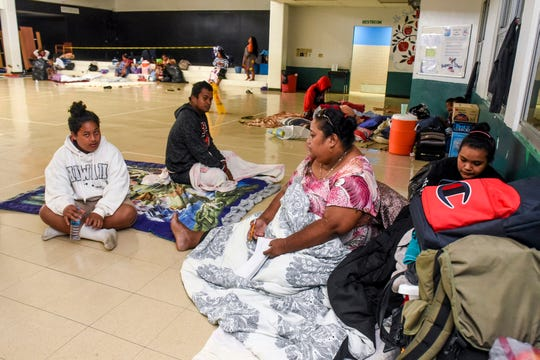 The Nedelec family awaken after a night spent at the temporary storm shelter established within Upi Elementary School in Yigo on Thursday, Oct. 25, 2018. The family, was one of seven others, who sought the safety of the shelter during the passage of Super Typhoon Yutu.