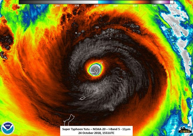 This satellite image, from the National Oceanic and Atmospheric Administration, shows the moment the eye of Super Typhoon Yutu passed directly over Tinian, in the Commonwealth of the Northern Mariana Islands, early Thursday, just before 2 a.m.