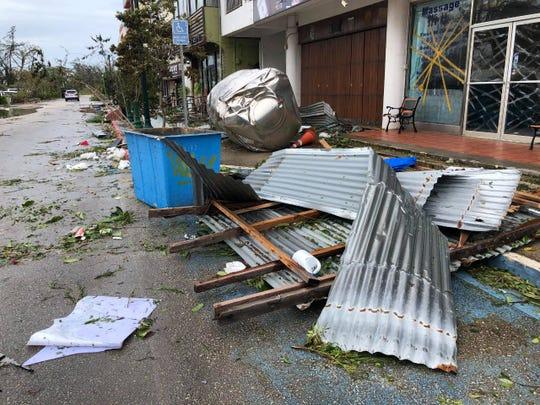 Debris on Coral Tree Avenue caused by Super Typhoon Yutu in Saipan
