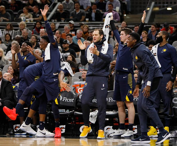 SAN ANTONIO, TX - OCTOBER 24: Members of the Indiana Pacers celebrate after a Domantas Sabonis dunk against the San Antonio Spurs during an NBA game on October 24, 2018 at the AT&T Center in San Antonio, Texas.  NOTE TO USER: User expressly acknowledges and agrees that, by downloading and or using this photograph, User is consenting to the terms and conditions of the Getty Images License Agreement.  (Photo by Edward A. Ornelas/Getty Images)