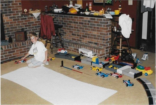 A young Matt Taylor created his own version of the Indy 500 in his home, then proceeded to introduce the starting lineup and call the action.
