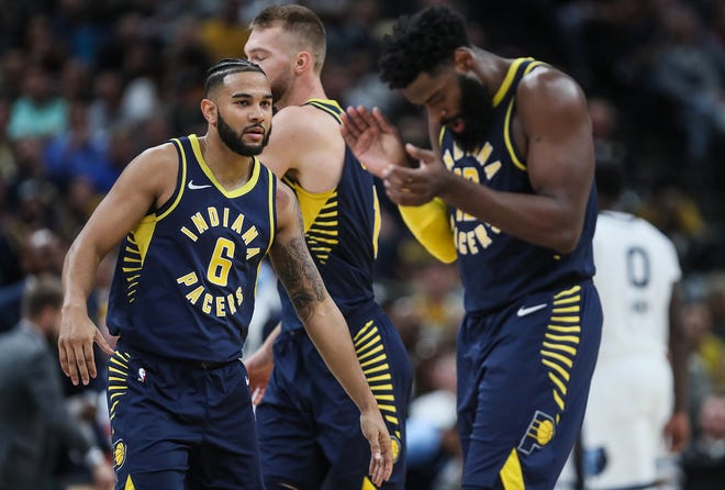 From right, Indiana Pacers guard Tyreke Evans (12) claps after Indiana Pacers guard Cory Joseph (6) scored during the second half of the season opener at Banker's Life Fieldhouse in Indianapolis, Wednesday, Oct. 17, 2018.